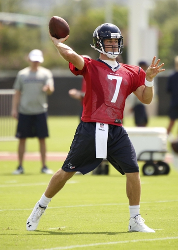 Jun 17, 2014; Houston, TX, USA; Houston Texans quarterback Case Keenum (7) goes through drills during mini camp at Houston Methodist Training Center. Mandatory Credit: Andrew Richardson-USA TODAY Sports