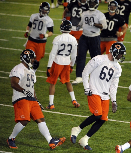 Jun 17, 2014; Lake Forest, IL, USA;  Chicago Bears defensive end  Jared Allen  (69) and outside linebacker Lance Briggs (55) during Chicago Bears minicamp at Halas Hall. Mandatory Credit: David Banks-USA TODAY Sports