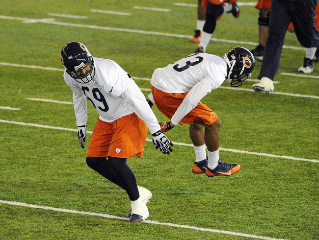 Jun 17, 2014; Lake Forest, IL, USA;  Chicago Bears defensive end  Jared Allen  (69) and safety Kyle Fuller (23) during Chicago Bears minicamp at Halas Hall. Mandatory Credit: David Banks-USA TODAY Sports