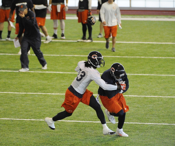Jun 17, 2014; Lake Forest, IL, USA; Chicago Bears wide receiver Alshon Jeffery (17) and cornerback Charles Tillman (33) during Chicago Bears minicamp at Halas Hall. Mandatory Credit: David Banks-USA TODAY Sports