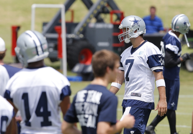 Jun 17, 2014; Dallas, TX, USA; Dallas Cowboys quarterback Tony Romo (9) smiles as he wears jersey number 7 he borrowed from Caleb Hanie (not pictured) after leaving the number ones live drill during minicamp at Cowboys headquarters at Valley Ranch. Mandatory Credit: Matthew Emmons-USA TODAY Sports