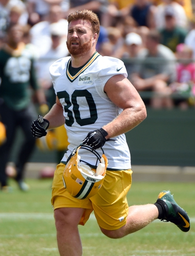 Jun 17, 2014; Green Bay, WI, USA;  Green Bay Packers fullback John Kuhn practices at the team's minicamp at Ray Nitschke Field. Mandatory Credit: Benny Sieu-USA TODAY Sports