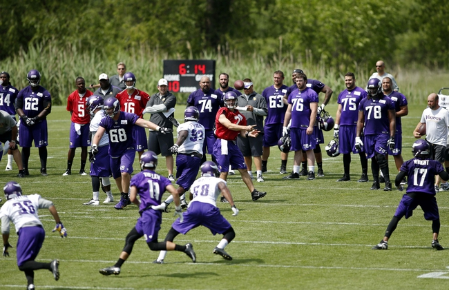 Jun 17, 2014; Eden Prairie, MN, USA; Minnesota Vikings quarterback Christian Ponder (7) leads a pass play with his team at practice at Winter Park. Mandatory Credit: Bruce Kluckhohn-USA TODAY Sports