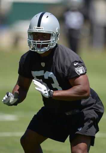 Jun 17, 2014; Alameda, CA, USA; Oakland Raiders linebacker Nick Roach (53) at minicamp at Raiders Practice Facility. Mandatory Credit: Kirby Lee-USA TODAY Sports