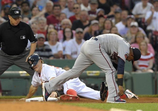 Jun 17, 2014; Boston, MA, USA; Boston Red Sox center fielder Brock Holt (26) steals third base past the tag of Minnesota Twins third baseman  Eduardo Escobar (5) during the third inning at Fenway Park. Mandatory Credit: Bob DeChiara-USA TODAY Sports