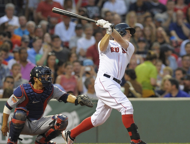 Jun 17, 2014; Boston, MA, USA; Boston Red Sox center fielder Brock Holt (26) hits a double during the third inning against the Minnesota Twins at Fenway Park. Mandatory Credit: Bob DeChiara-USA TODAY Sports