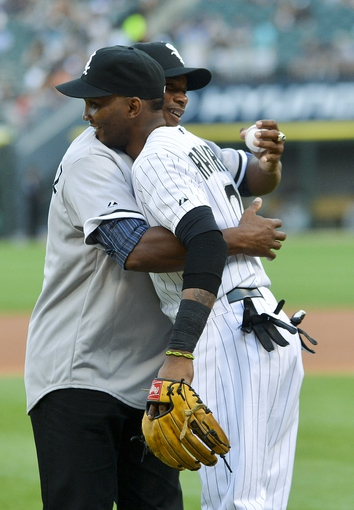 Jun 17, 2014; Chicago, IL, USA; Chicago White Sox former pitcher Orlando Hernandez hugs Chicago White Sox shortstop Alexei Ramirez (10) after he threw out the first pitch before the game against the San Francisco Giants at U.S Cellular Field. Mandatory Credit: Matt Marton-USA TODAY Sports