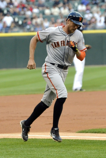 Jun 17, 2014; Chicago, IL, USA; San Francisco Giants right fielder Hunter Pence (8) rounds the bases as he scores in the first inning against the Chicago White Sox at U.S Cellular Field. Mandatory Credit: Matt Marton-USA TODAY Sports