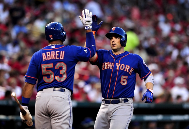 Jun 17, 2014; St. Louis, MO, USA; New York Mets third baseman David Wright (5) is congratulated by right fielder Bobby Abreu (53) after hitting a solo home run off of St. Louis Cardinals starting pitcher Michael Wacha (not pictured) during the fourth inning at Busch Stadium. Mandatory Credit: Jeff Curry-USA TODAY Sports