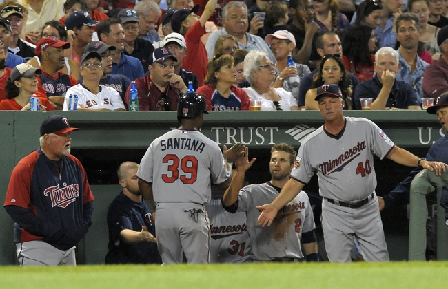 Jun 17, 2014; Boston, MA, USA; Minnesota Twins center fielder Danny Santana (39) is greeted in the dugout after scoring a run during the sixth inning against the Boston Red Sox at Fenway Park. Mandatory Credit: Bob DeChiara-USA TODAY Sports