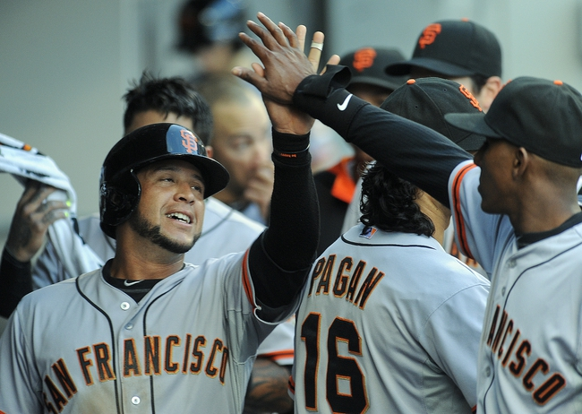 Jun 17, 2014; Chicago, IL, USA; San Francisco Giants left fielder Gregor Blanco (left) gets high-fives after he scored in the third inning against the Chicago White Sox at U.S Cellular Field. Mandatory Credit: Matt Marton-USA TODAY Sports