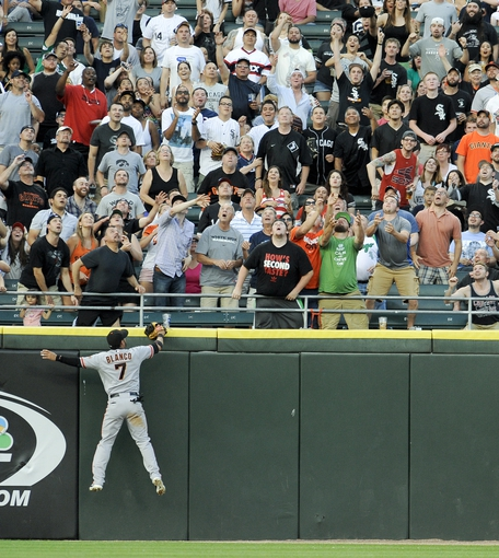 Jun 17, 2014; Chicago, IL, USA; San Francisco Giants left fielder Gregor Blanco (7) tries to catch Chicago White Sox second baseman Gordon Beckham (not pictured) 2-run home run in the third inning against the San Francisco Giants at U.S Cellular Field. Mandatory Credit: Matt Marton-USA TODAY Sports