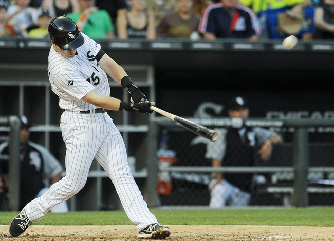 Jun 17, 2014; Chicago, IL, USA; Chicago White Sox second baseman Gordon Beckham (15) hits a 2-run home run in the third inning against the San Francisco Giants at U.S Cellular Field. Mandatory Credit: Matt Marton-USA TODAY Sports