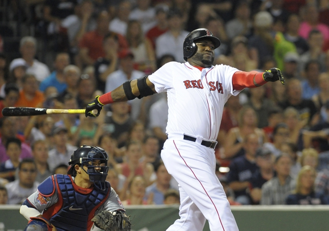Jun 17, 2014; Boston, MA, USA; Boston Red Sox designated hitter David Ortiz (34) hits a single during the sixth inning against the Minnesota Twins at Fenway Park. Mandatory Credit: Bob DeChiara-USA TODAY Sports