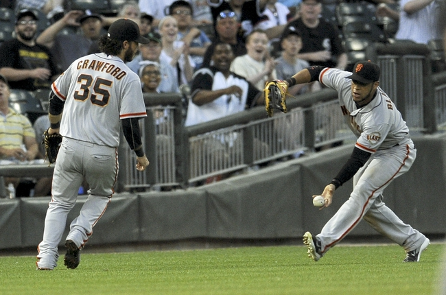 Jun 17, 2014; Chicago, IL, USA; San Francisco Giants shortstop Brandon Crawford (35) and left fielder Gregor Blanco (7) miss a fly ball in the fourth inning against theChicago White Sox at U.S Cellular Field. Mandatory Credit: Matt Marton-USA TODAY Sports
