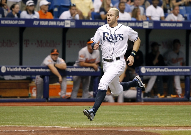 Jun 17, 2014; St. Petersburg, FL, USA; Tampa Bay Rays third baseman Evan Longoria (3) runs home to score a run during the fifth inning against the Baltimore Orioles at Tropicana Field. Mandatory Credit: Kim Klement-USA TODAY Sports