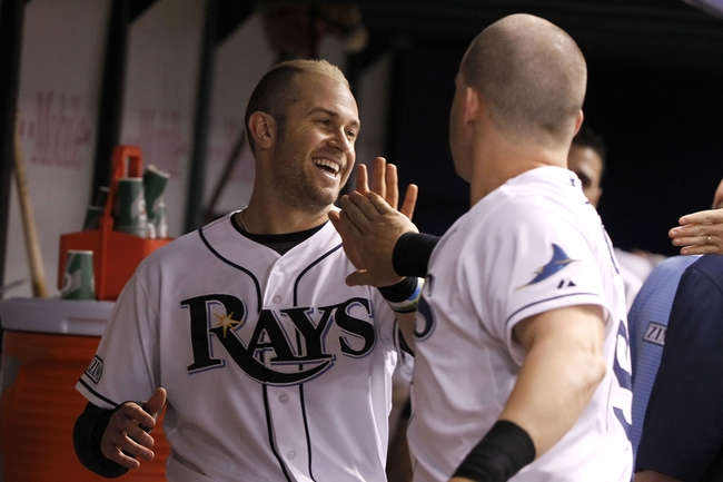 Jun 17, 2014; St. Petersburg, FL, USA; Tampa Bay Rays third baseman Evan Longoria (3) is congratulated by right fielder Jerry Sands (19) in the dugout after he scored during the fifth inning against the Baltimore Orioles at Tropicana Field. Mandatory Credit: Kim Klement-USA TODAY Sports