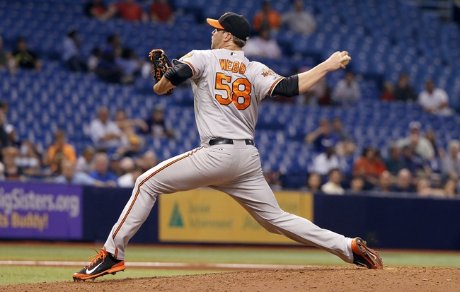 Jun 17, 2014; St. Petersburg, FL, USA; Baltimore Orioles relief pitcher Ryan Webb (58) throws a pitch during the sixth inning against the Tampa Bay Rays at Tropicana Field. Mandatory Credit: Kim Klement-USA TODAY Sports