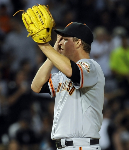 Jun 17, 2014; Chicago, IL, USA; San Francisco Giants starting pitcher Matt Cain (18) reacts after Chicago White Sox right fielder Dayan Viciedo (not pictured) hits a 2-run home run in the sixth inning against the San Francisco Giants at U.S Cellular Field. Mandatory Credit: Matt Marton-USA TODAY Sports