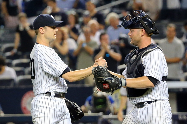 Jun 17, 2014; Bronx, NY, USA;  New York Yankees relief pitcher David Robertson (30) and catcher Brian McCann (34) celebrate the win against the Toronto Blue Jays at Yankee Stadium. New York Yankees won 3-1. Mandatory Credit: Anthony Gruppuso-USA TODAY Sports