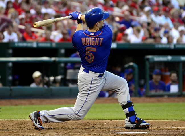 Jun 17, 2014; St. Louis, MO, USA; New York Mets third baseman David Wright (5) hits a solo home run off of St. Louis Cardinals starting pitcher Michael Wacha (not pictured) during the fourth inning at Busch Stadium. Mandatory Credit: Jeff Curry-USA TODAY Sports