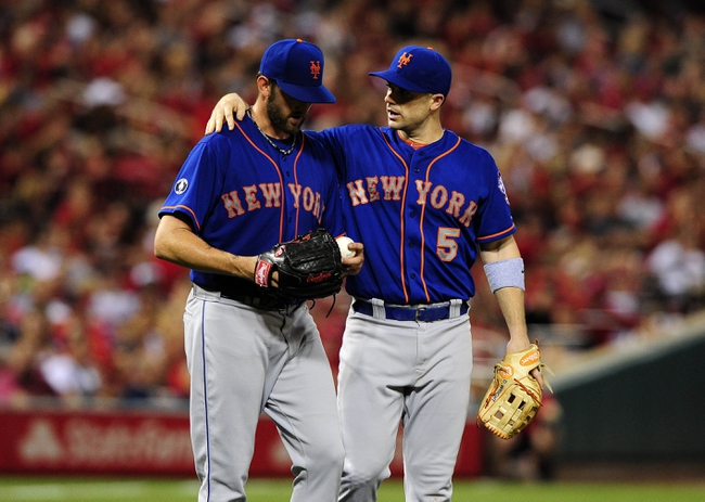 Jun 17, 2014; St. Louis, MO, USA; New York Mets third baseman David Wright (5) talks with starting pitcher Jonathon Niese (49) during the sixth inning against the St. Louis Cardinals at Busch Stadium. Mandatory Credit: Jeff Curry-USA TODAY Sports