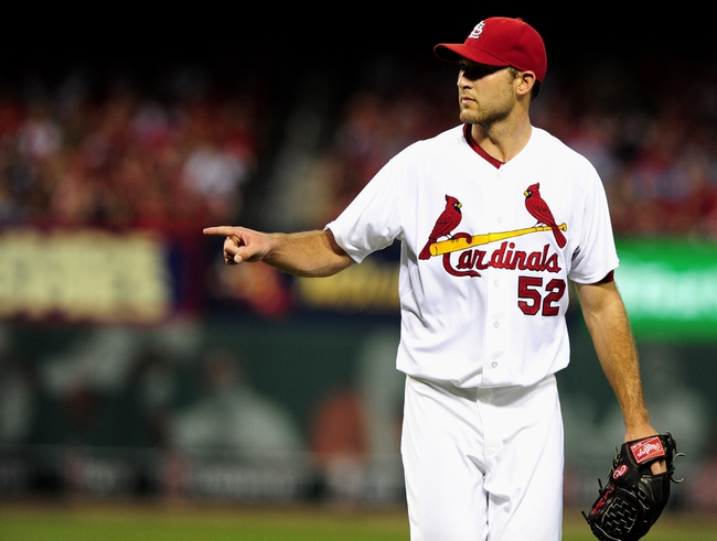 Jun 17, 2014; St. Louis, MO, USA; St. Louis Cardinals starting pitcher Michael Wacha (52) points to catcher Yadier Molina (not pictured) after getting out of the fourth inning against the New York Mets at Busch Stadium. Mandatory Credit: Jeff Curry-USA TODAY Sports