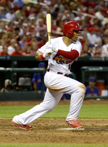 Jun 17, 2014; St. Louis, MO, USA; St. Louis Cardinals right fielder Jon Jay (19) hits a one run triple off of New York Mets starting pitcher Jonathon Niese (not pictured) during the fifth inning at Busch Stadium. Mandatory Credit: Jeff Curry-USA TODAY Sports