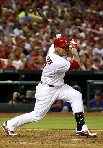 Jun 17, 2014; St. Louis, MO, USA; St. Louis Cardinals left fielder Matt Holliday (7) hits a one run double off of New York Mets starting pitcher Jonathon Niese (not pictured) during the fifth inning at Busch Stadium. Mandatory Credit: Jeff Curry-USA TODAY Sports