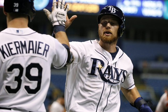 Jun 17, 2014; St. Petersburg, FL, USA; Tampa Bay Rays second baseman Ben Zobrist (18) is congratulated by right fielder Kevin Kiermaier (39) after he scored during the eighth inning against the Baltimore Orioles at Tropicana Field. Baltimore Orioles defeated the Tampa Bay Rays 7-5. Mandatory Credit: Kim Klement-USA TODAY Sports