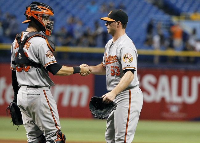 Jun 17, 2014; St. Petersburg, FL, USA; Baltimore Orioles relief pitcher Zach Britton (53) and catcher Caleb Joseph (36) celebrate after they beat the Tampa Bay Rays at Tropicana Field. Baltimore Orioles defeated the Tampa Bay Rays 7-5. Mandatory Credit: Kim Klement-USA TODAY Sports