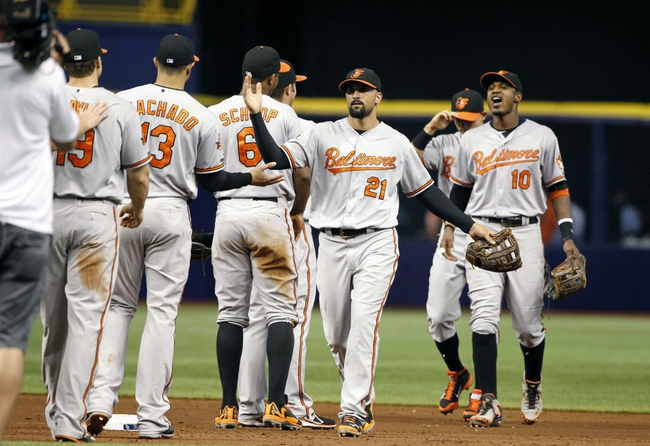 Jun 17, 2014; St. Petersburg, FL, USA; Baltimore Orioles right fielder Nick Markakis (21), center fielder Adam Jones (10) and teammates high five after they beat the Tampa Bay Rays at Tropicana Field. Baltimore Orioles defeated the Tampa Bay Rays 7-5. Mandatory Credit: Kim Klement-USA TODAY Sports