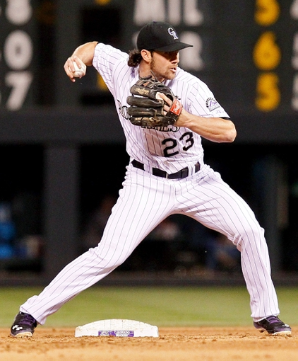 May 6, 2014; Denver, CO, USA; Colorado Rockies second baseman Charlie Culberson (23) turns a double play in the sixth inning against the Texas Rangers at Coors Field. Mandatory Credit: Isaiah J. Downing-USA TODAY Sports