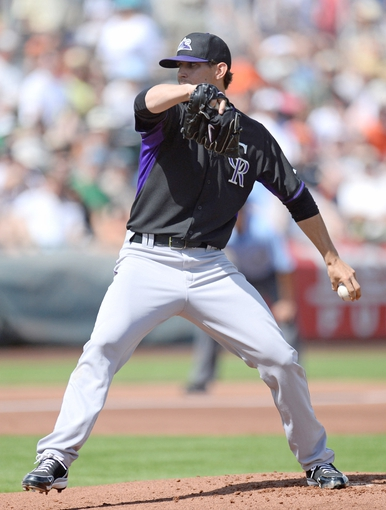 Mar 14, 2014; Scottsdale, AZ, USA; Colorado Rockies starting pitcher Christian Friedrich (53) pitches in the first inning against the San Francisco Giants at Scottsdale Stadium. Mandatory Credit: Joe Camporeale-USA TODAY Sports