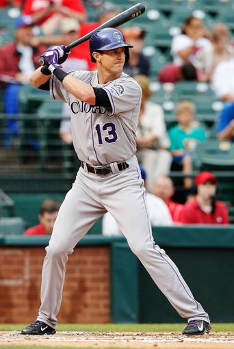 May 8, 2014; Arlington, TX, USA; Colorado Rockies center fielder Drew Stubbs (13) bats during the game against the Texas Rangers at Globe Life Park in Arlington. Texas won 5-0. Mandatory Credit: Kevin Jairaj-USA TODAY Sports