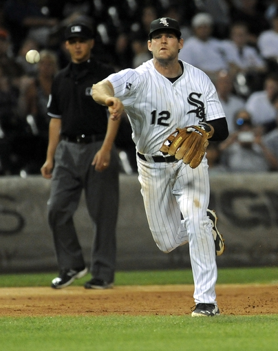 Jun 17, 2014; Chicago, IL, USA; Chicago White Sox third baseman Conor Gillaspie (12) throws San Francisco Giants left fielder Juan Perez (2) out at first base in the  ninth inning at U.S Cellular Field. Mandatory Credit: Matt Marton-USA TODAY Sports