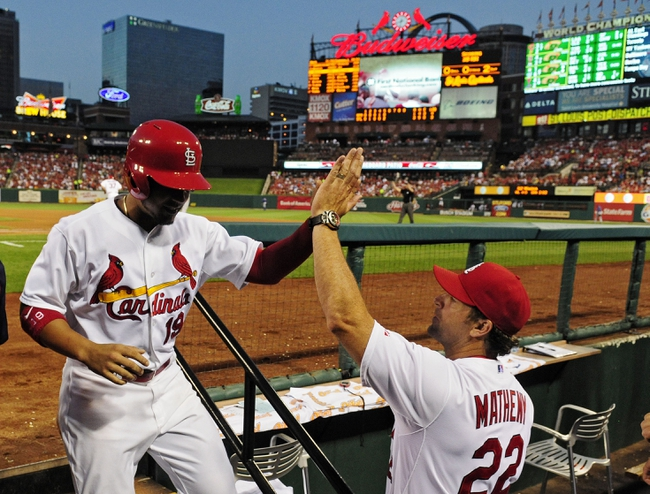 Jun 17, 2014; St. Louis, MO, USA; St. Louis Cardinals center fielder Jon Jay (19) high fives manager Mike Matheny (22) after scoring during the fifth inning against the New York Mets at Busch Stadium. The Cardinals defeated the Mets 5-2. Mandatory Credit: Jeff Curry-USA TODAY Sports