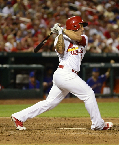 Jun 17, 2014; St. Louis, MO, USA; St. Louis Cardinals pinch hitter Kolten Wong (16) hits a one run single off of New York Mets starting pitcher Jonathon Niese (not pictured) during the sixth inning at Busch Stadium. The Cardinals defeated the Mets 5-2. Mandatory Credit: Jeff Curry-USA TODAY Sports