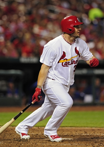 Jun 17, 2014; St. Louis, MO, USA; St. Louis Cardinals pinch hitter Matt Adams (32) hits a single off of New York Mets relief pitcher Jeurys Familia (not pictured) during the eighth inning at Busch Stadium. The Cardinals defeated the Mets 5-2. Mandatory Credit: Jeff Curry-USA TODAY Sports