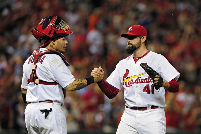 Jun 17, 2014; St. Louis, MO, USA; St. Louis Cardinals relief pitcher Pat Neshek (41) celebrates with catcher Yadier Molina (4) after defeating the New York Mets at Busch Stadium. The Cardinals defeated the Mets 5-2. Mandatory Credit: Jeff Curry-USA TODAY Sports