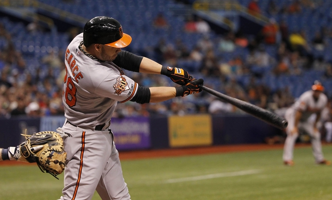 Jun 18, 2014; St. Petersburg, FL, USA; Baltimore Orioles first baseman Steve Pearce (28) hits a RBI double during the fifth inning against the Tampa Bay Rays at Tropicana Field. Mandatory Credit: Kim Klement-USA TODAY Sports