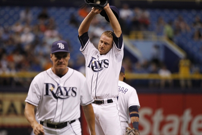 Jun 18, 2014; St. Petersburg, FL, USA; Tampa Bay Rays starting pitcher Alex Cobb (53) reacts after he talked with pitching coach Jim Hickey (48) against the Baltimore Orioles  during the fifth inning at Tropicana Field. Mandatory Credit: Kim Klement-USA TODAY Sports