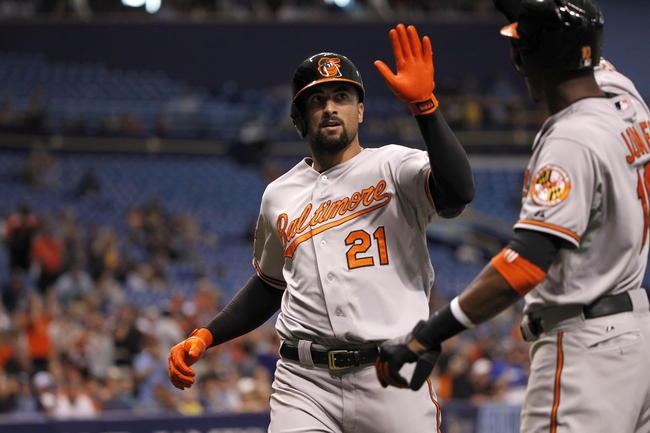 Jun 18, 2014; St. Petersburg, FL, USA; Baltimore Orioles right fielder Nick Markakis (21) is congratulated by center fielder Adam Jones (10) after he scored during the fifth inning against the Tampa Bay Rays at Tropicana Field. Mandatory Credit: Kim Klement-USA TODAY Sports