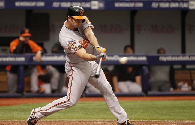 Jun 18, 2014; St. Petersburg, FL, USA; Baltimore Orioles shortstop J.J. Hardy (2) singles during the sixth inning against the Tampa Bay Rays at Tropicana Field. Mandatory Credit: Kim Klement-USA TODAY Sports