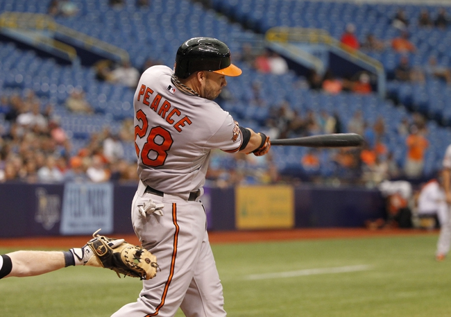 Jun 18, 2014; St. Petersburg, FL, USA; Baltimore Orioles first baseman Steve Pearce (28) doubles during the ninth inning against the Tampa Bay Rays at Tropicana Field. Baltimore Orioles defeated the Tampa Bay Rays 2-0. Mandatory Credit: Kim Klement-USA TODAY Sports
