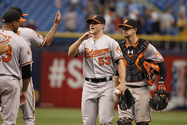 Jun 18, 2014; St. Petersburg, FL, USA; Baltimore Orioles relief pitcher Zach Britton (53), catcher Caleb Joseph (36) and teammates high five after hey beat the Tampa Bay Rays at Tropicana Field. Baltimore Orioles defeated the Tampa Bay Rays 2-0. Mandatory Credit: Kim Klement-USA TODAY Sports