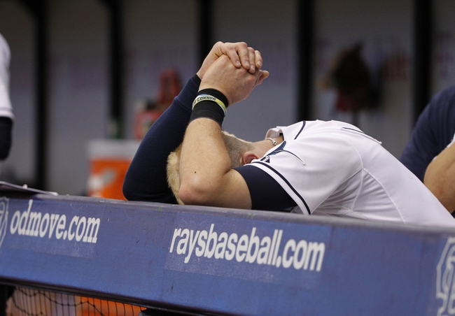 Jun 18, 2014; St. Petersburg, FL, USA; Tampa Bay Rays third baseman Evan Longoria (3) reacts with his head down in the dugout during the eighth inning against the Baltimore Orioles at Tropicana Field. Baltimore Orioles defeated the Tampa Bay Rays 2-0. Mandatory Credit: Kim Klement-USA TODAY Sports