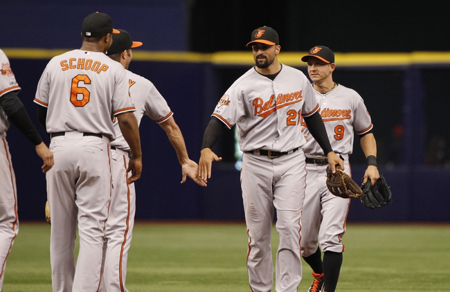Jun 18, 2014; St. Petersburg, FL, USA; Baltimore Orioles right fielder Nick Markakis (21) and teammates high five after they beat the Tampa Bay Rays at Tropicana Field. Baltimore Orioles defeated the Tampa Bay Rays 2-0. Mandatory Credit: Kim Klement-USA TODAY Sports