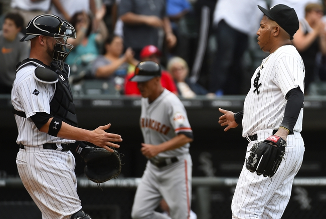 Jun 18, 2014; Chicago, IL, USA; Chicago White Sox relief pitcher Ronald Belisario (54) reacts with catcher Tyler Flowers (21) after getting the save after the ninth inning at U.S Cellular Field. Chicago White Sox defeat San Francisco Giants 7-6. Mandatory Credit: Mike DiNovo-USA TODAY Sports