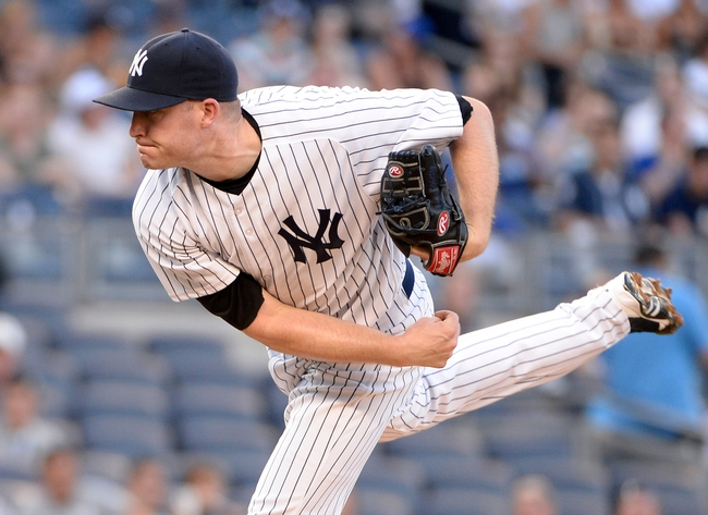Jun 18, 2014; Bronx, NY, USA; New York Yankees starting pitcher Chase Whitley throws a pitch against the Toronto Blue Jays in the first inning during the MLB baseball game at Yankee Stadium. Mandatory Credit: Robert Deutsch-USA TODAY Sports